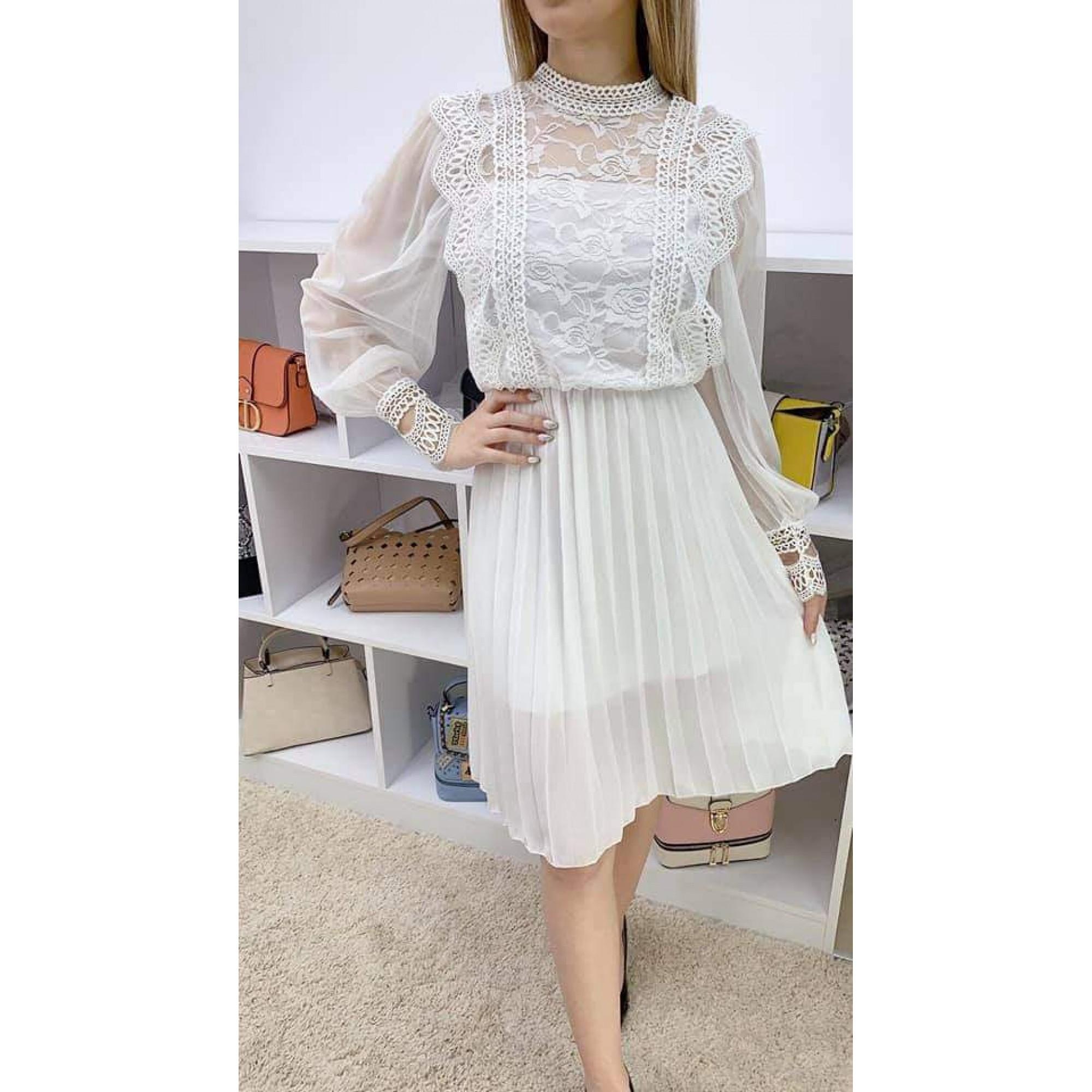 Нежна дамска рокля в бяло